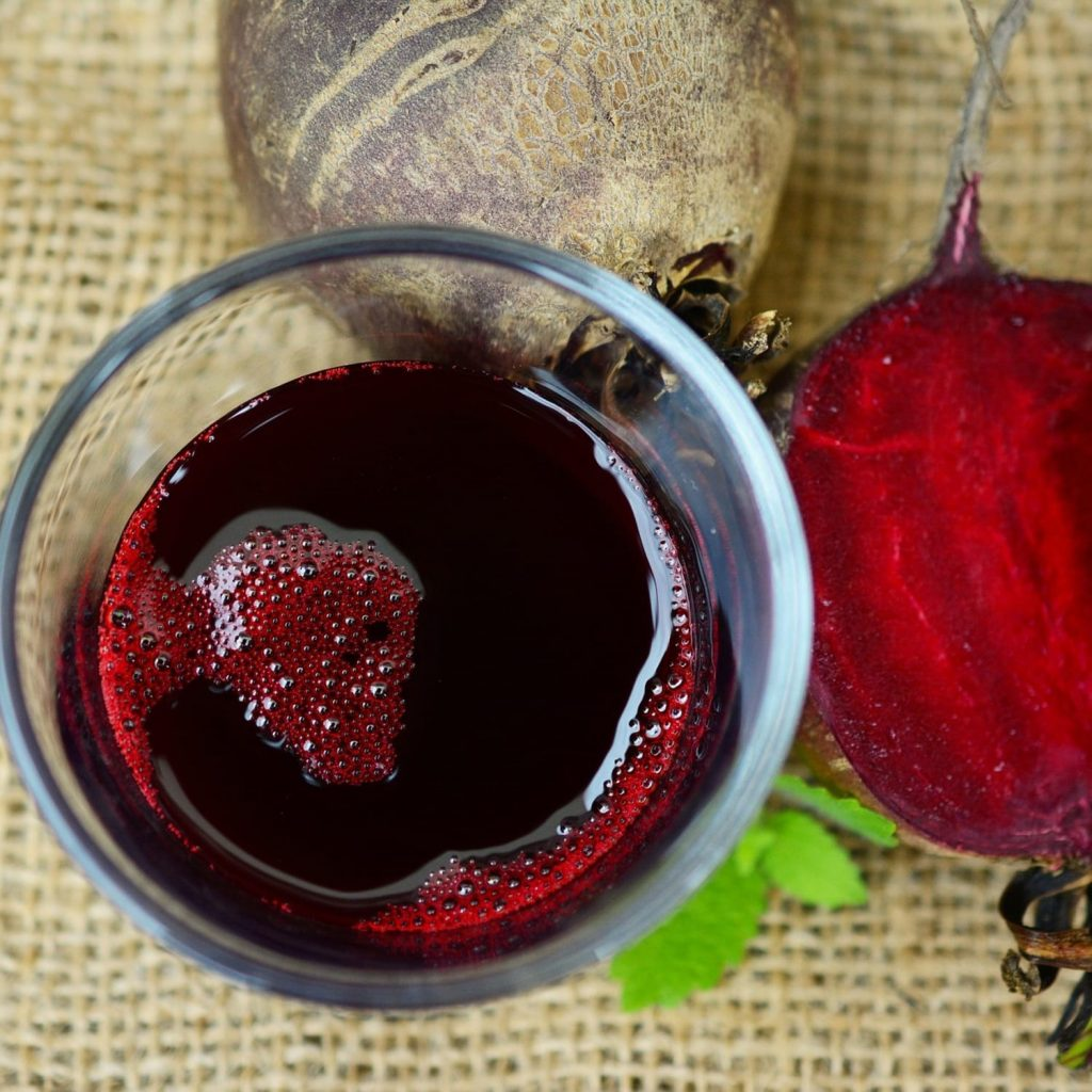 beetroot whole and beetroot juice in a glass