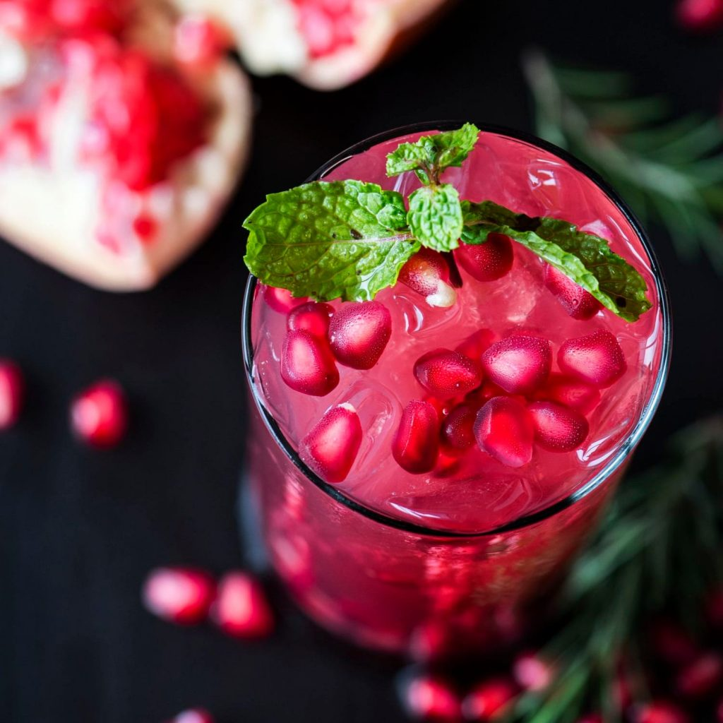 pomegranate and pomegranate seeds in a juice